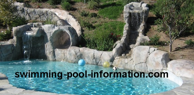 the round donut on the pool below is a cement water slide coated in smooth plaster - Swimming Pools With Waterfalls And Slide